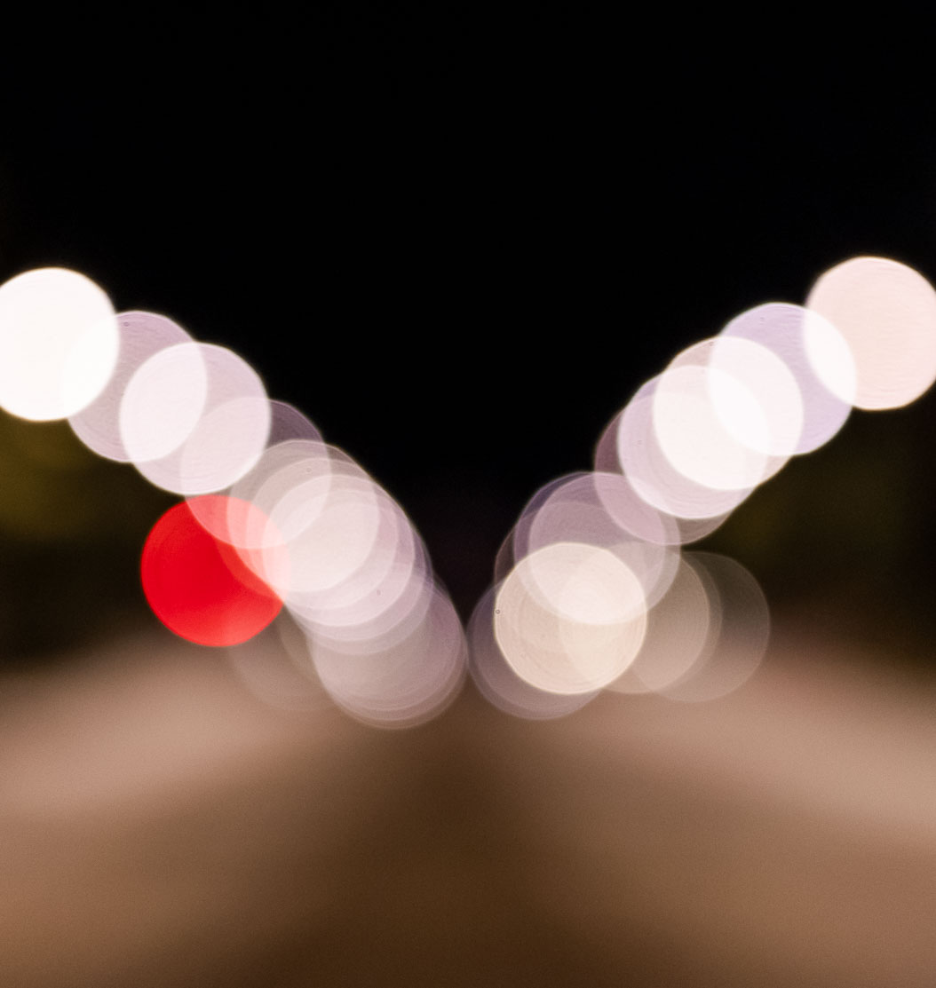 Out of focus picture of a road at night