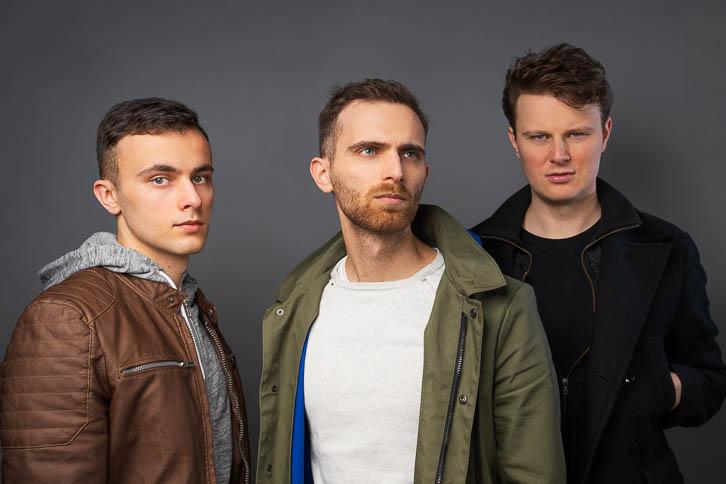 Professional photo of Gandekko band members in front of grey background paper