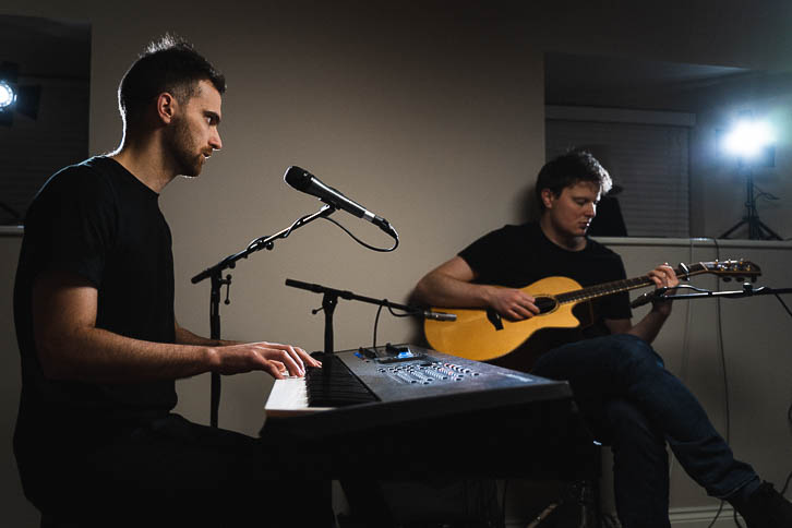 Alastair and Kelvin playing keyboard and Guitar in a bedroom music room