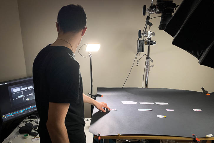 Band member gavin animating on stop motion table
