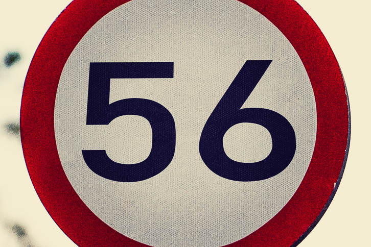 Red ring white road sign with 56 written on it