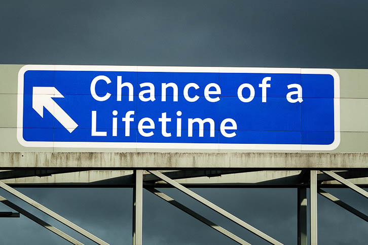 M1 Motorway sign saying Chance of a Lifetime exit left