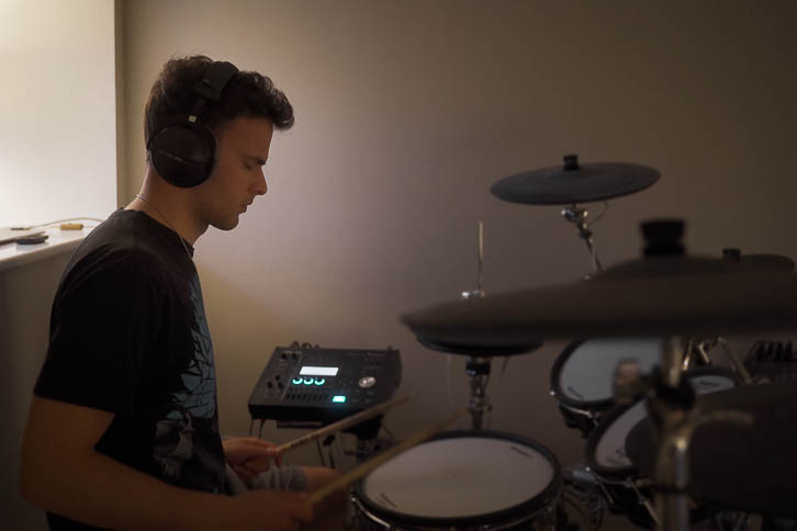 Gavin playing Roland electronic drums in bedroom music room
