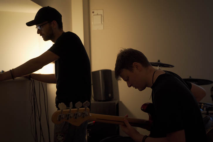 Alastair directing Kelvin who is recording electric bass