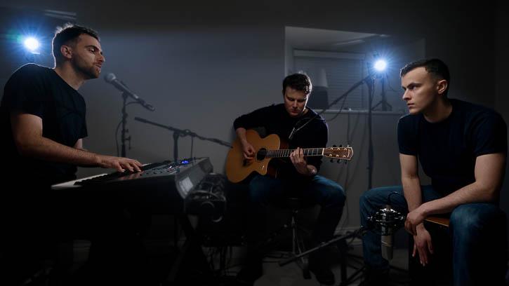 Gandekko band members playing acoustic instruments in bedroom music room