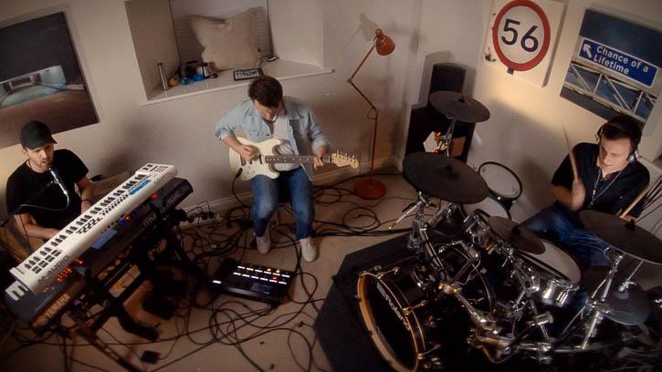 Looking down on Gandekko's rock performance in a bedroom